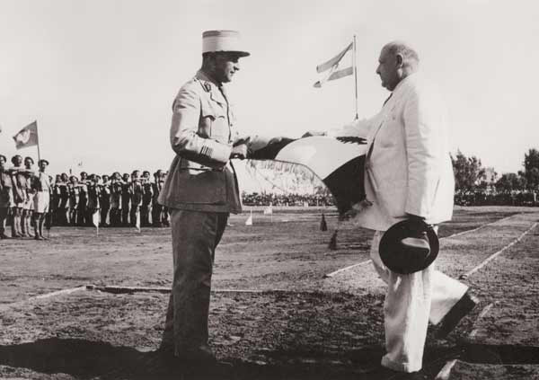 The President of the Lebanese Republic Bechara el-Khoury handing over the Lebanese flag to Major General Fouad Chehab on the 17th of June 1944